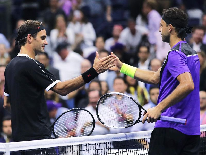 Grigor Dimitrov, of Bulgaria, right, shakes hands with Roger Federer