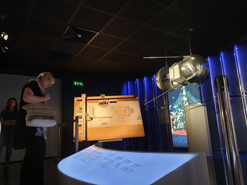 A visitor checking out a replica of the Sputnik 1, the first man-made satellite launched to space.-1567760393059