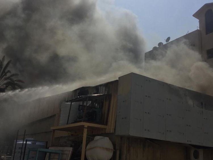 NAT 190911 Fire guts food stuff  warehouse in Ajman1-1568201136382
