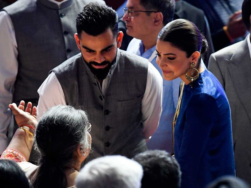 Indian cricket captain Virat Kohli (L) and wife Anushka Sharma speak with a relative of the late finance minister Arun Jaitley at the Delhi cricket association ceremony to rename the Feroz Shah Kotla cricket stadium to Arun Jaitley stadium, in New Delhi on September 12, 2019.