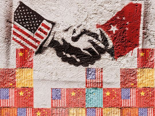 Stencil graffiti representing the agreement of two countries (USA - CHINA). Photographer's own design.