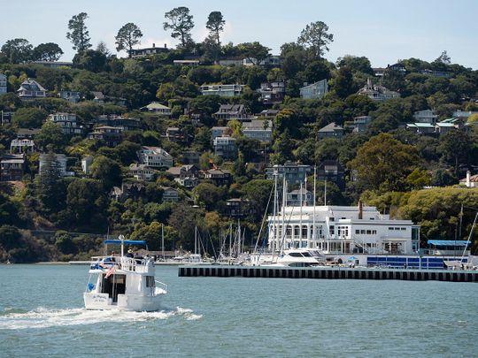 A boat motors toward the Corinthian Yacht Club in Tiburon