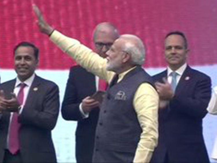 Prime Minister Narendra Modi arrives on stage at NRG stadium in Houston