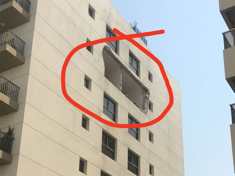The suspected explosion inside a unit on the sixth floor damaged windows0001