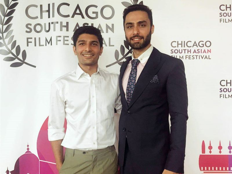 Ahmed Ali Akbar (R) with the executive producer of LAAL KABOOTAR Kamil Chima at the Chicago South Asian Film Festival-1569824287516