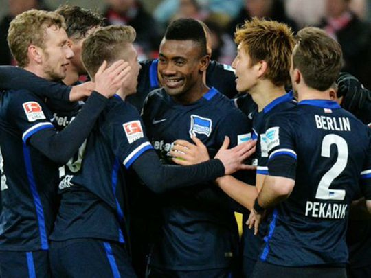Hertha Berlin players celebrate their win over Cologne