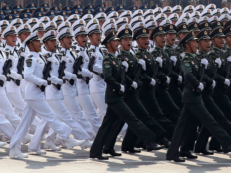 Members of a Chinese military honor guard march during