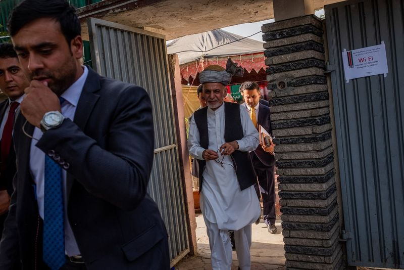 President Ashraf Ghani, center, and his chief rival in Afghanistan's election