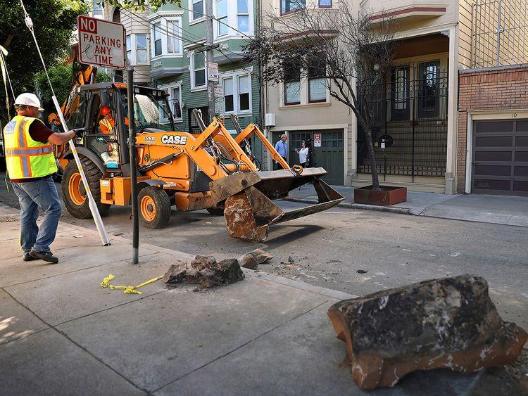 A San Francisco Public Works crew removes boulders