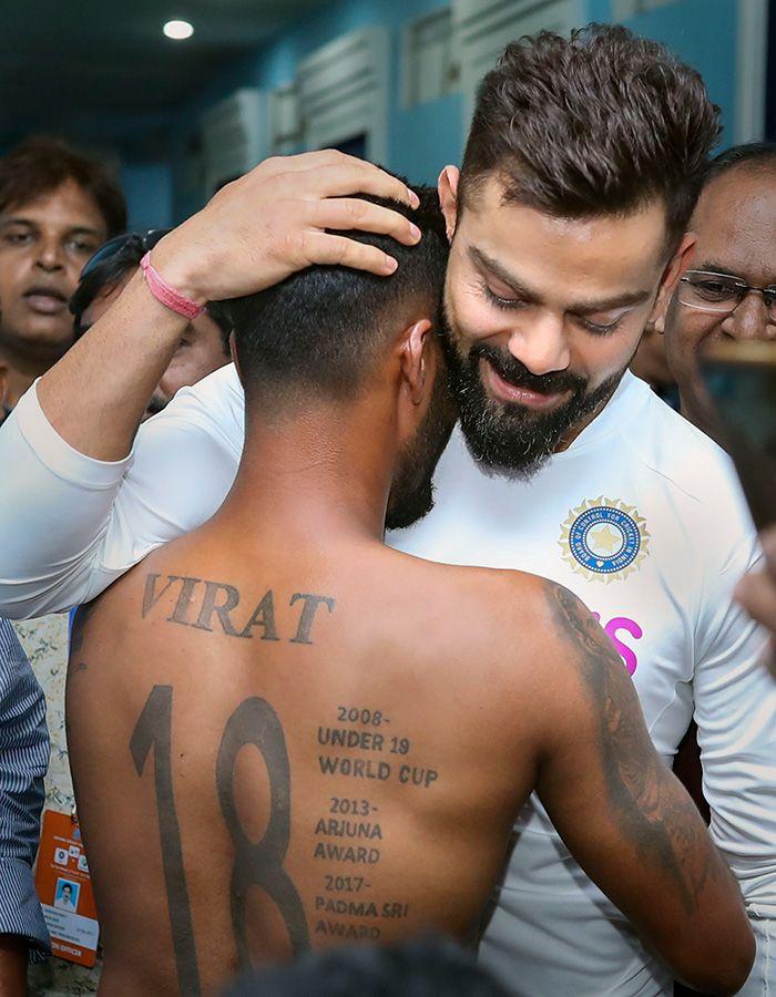 Virat Kohli hugs his fan Pintu Behra
