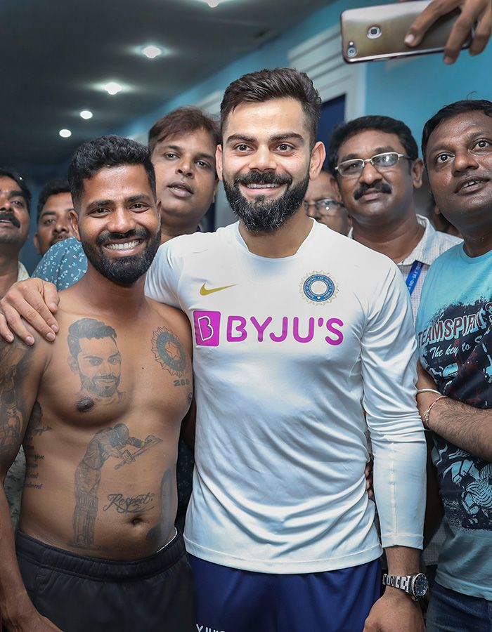 Virat Kohli poses for a photograph with his fan Pintu Behra