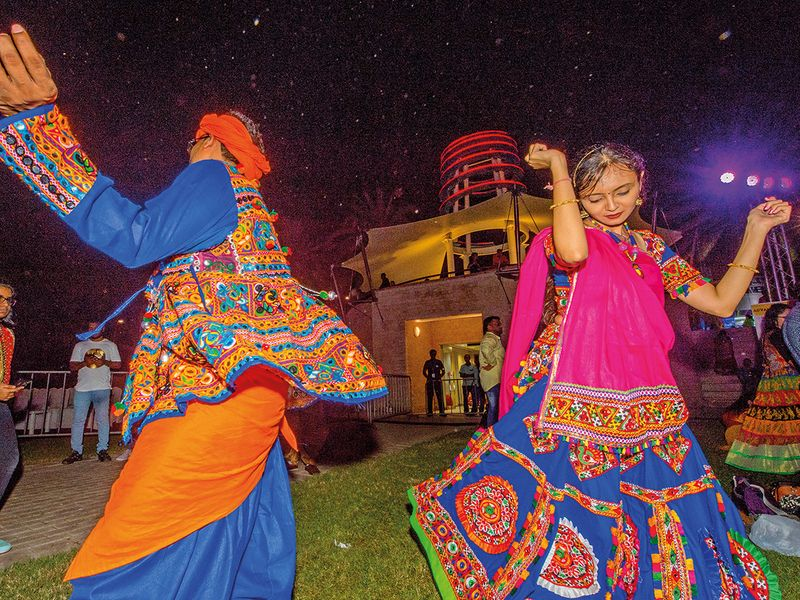 A couple performs a folk dance at Zabeel Park