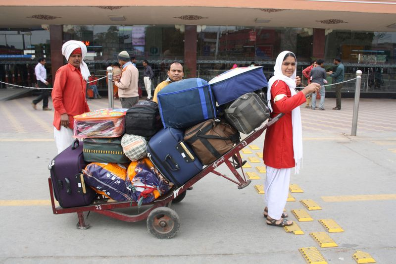 Pulling a trolley full of luggage (Photo Credit - NILIMA PATHAK)-1570186879590