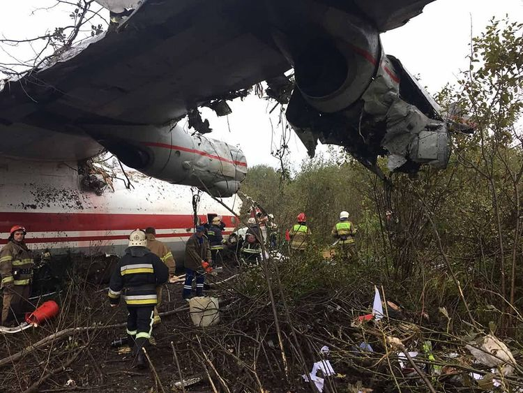 Rescuers at the plane crash site in a forest outside Lviv