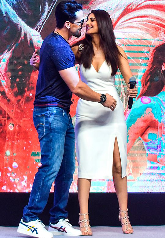 Tiger Shroff (L) embraces with actress Vaani Kapoor