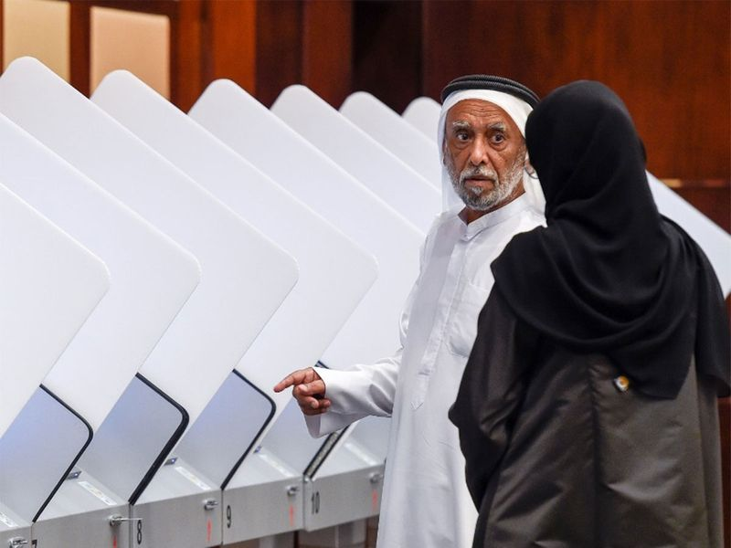 Emiratis cast their votes at a polling centre in the Dubai
