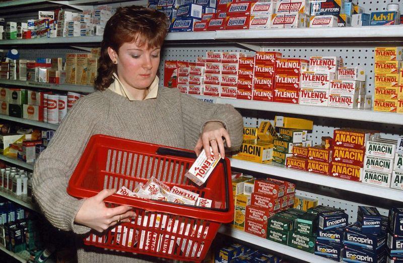 A drugstore clerk removes Tylenol 0121