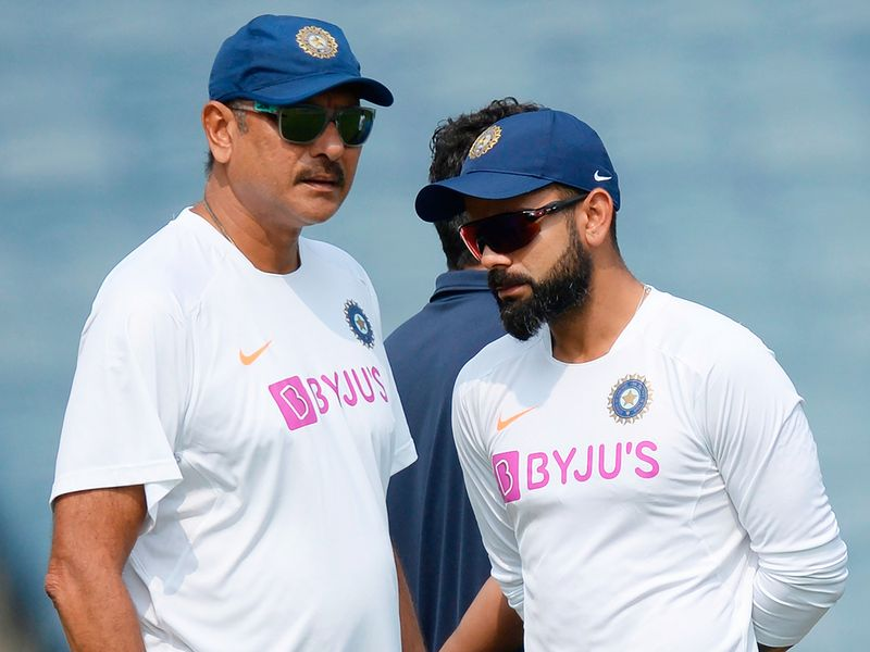 Virat Kohli (R) and coach Ravi Shastri