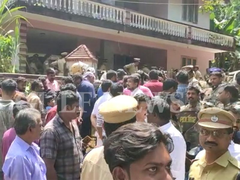 Crowd gathered outside the Ponnamattam house