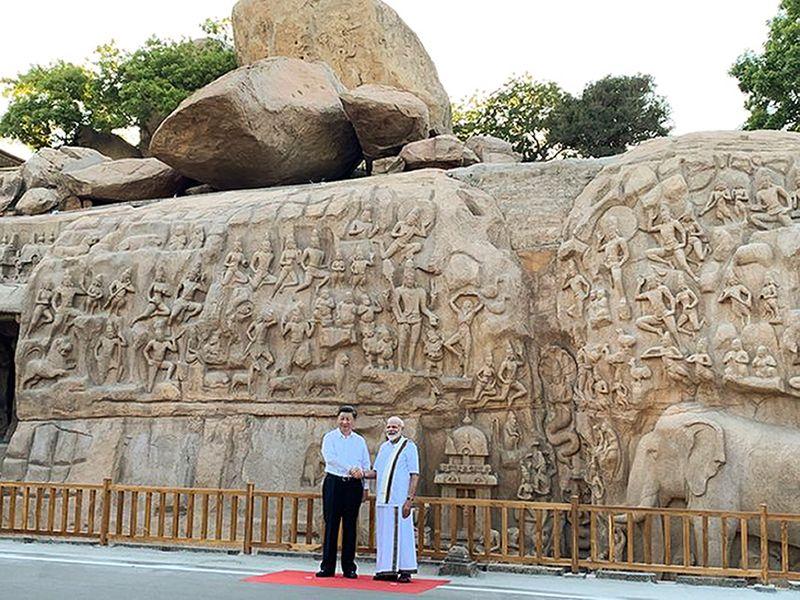 Modi shakes hands with Xi Jinping