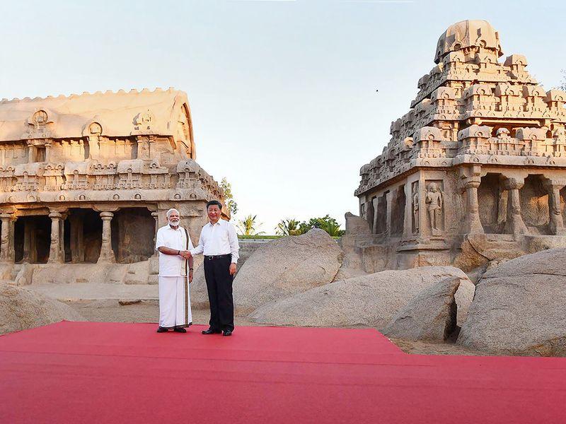 Narendra Modi shakes hands with Xi Jinping