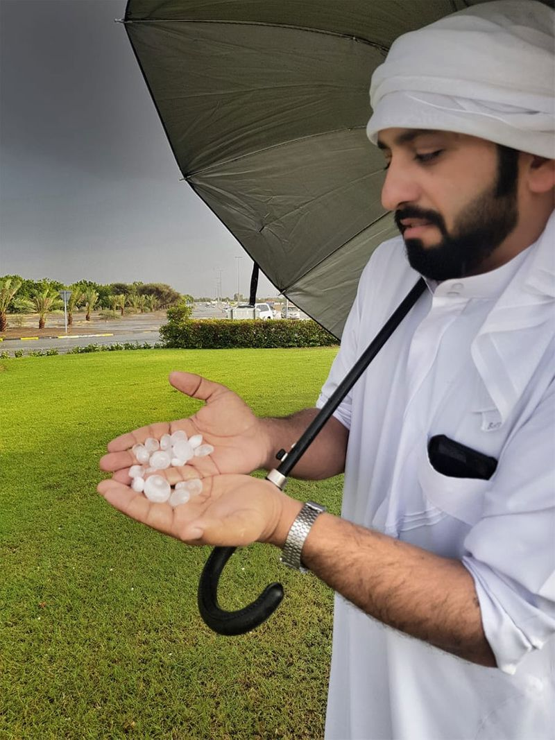 A man hold hail stones in Al Dhaid on Sunday, October 13, 2019.