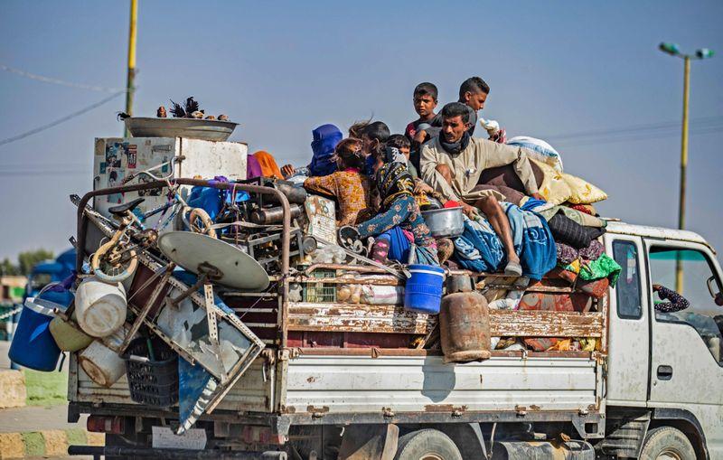 REG Kurds flee-1571221560637