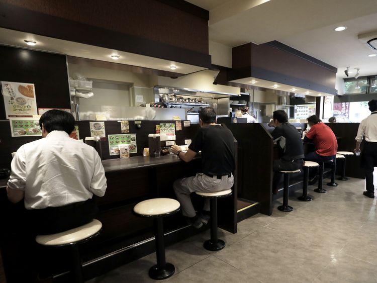 Customers dine inside a CoCo Ichibanya restaurant in Tokyo.-1571399652577