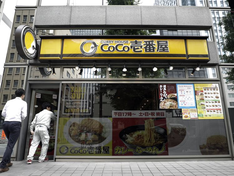 Customers enter a CoCo Ichibanya restaurant, operated by Ichibanya Co., in Tokyo.-1571399661045