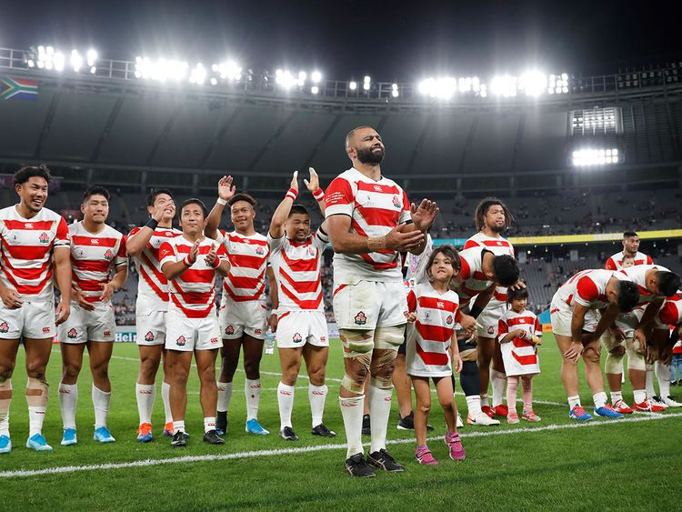 Japan applaud their fans after defeat to South Africa.