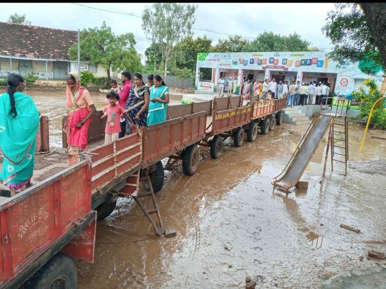 makeshift bridge of tractor-trolleys