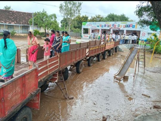 makeshift bridge of tractor-trolleys