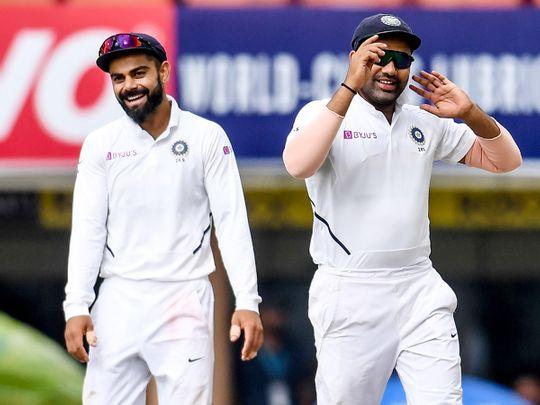 Virat Kohli (L) and teammate Rohit Sharma