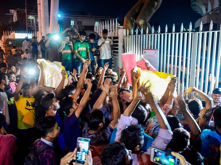 Cricket fans gather and shout slogans