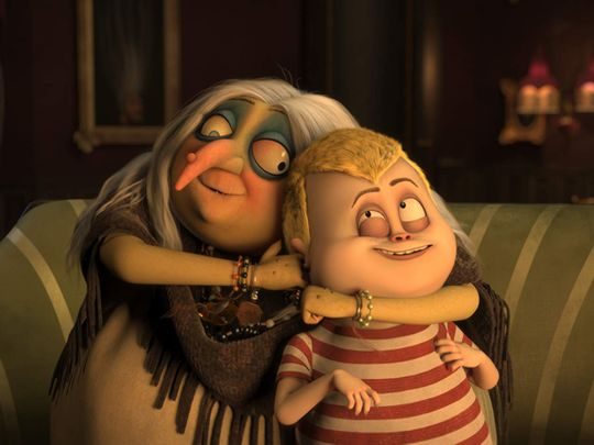 Bette Midler and Finn Wolfhard in The Addams Family-1572499365616