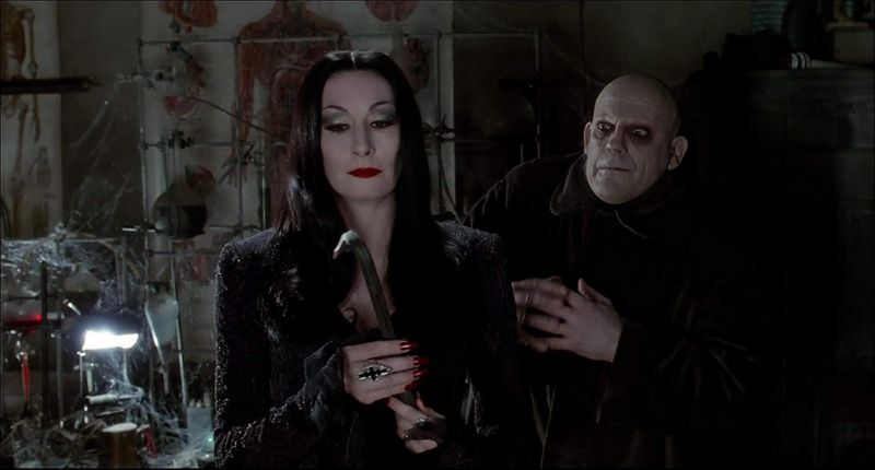 Christopher Lloyd and Anjelica Huston in The Addams Family (1991)-1572499355134