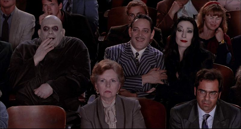 Raul Julia, Christopher Lloyd, and Anjelica Huston in The Addams Family (1991)-1572499359342