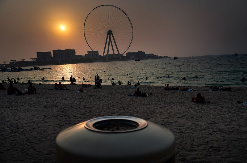 People spend an evening at the beach near Jumeirah Beach Residence, Dubai