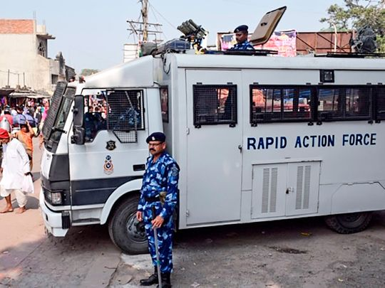 Rapid Action Force (RPF) personnel stand guard