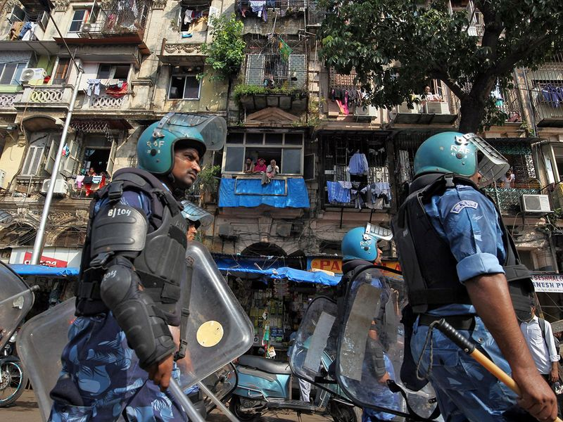 Rapid Action Force (RAF) personnel patrol in a residential area before Supreme Court's verdict on a disputed religious site in Ayodhya, in Mumbai, India