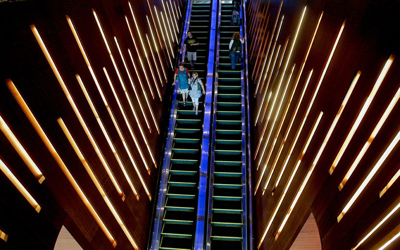 Guests using an escalator at a hotel in Dubai