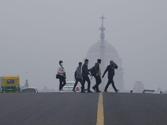 Eat carrots, sing or pray in Delhi's smog