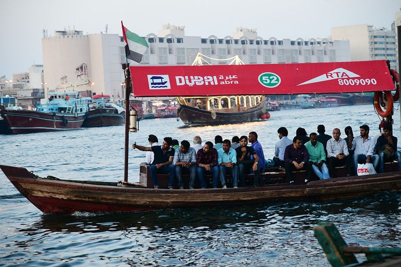 People crossing the Dubai creek in an Abra
