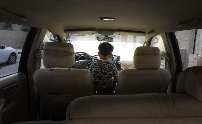 OPN 191115 kids in car-1573812229817