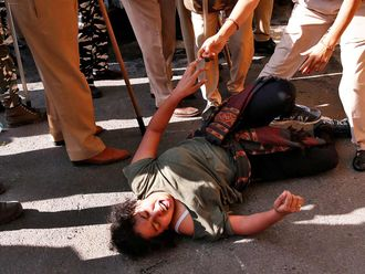 A student of Jawaharlal Nehru University (JNU) reacts as police try to detain her during a protest against a proposed fee hike, in New Delhi, India, November 18, 2019.