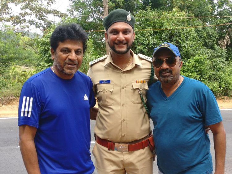 UAE resident Deepak S with Shiva Rajkumar and Producer Dwarikish on the sets of Ayushman Bhava-1574230220664