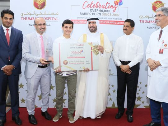 Sheikh Dr. Majid bin Saeed Al Nuaimi presenting the Gift Certificate to one of the first borns at the Thumbay Hospital Ajman Celebration Event-1574344838977
