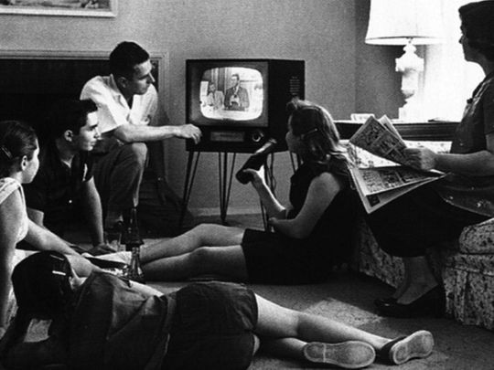 A family watching television US 1950s