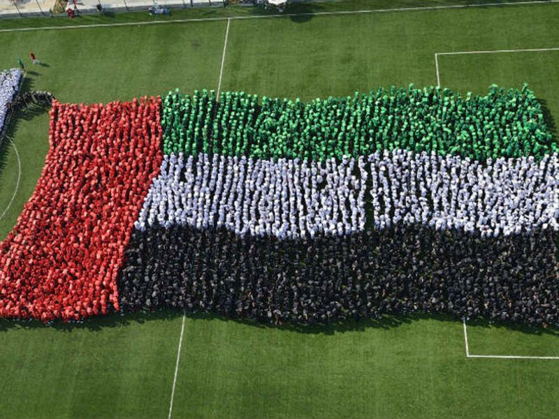 Largest human image of a waving national flag