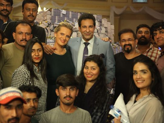 Shaneira and Waseem Akram, with the crew of MONEY BACK GUARANTEE-1574660578737